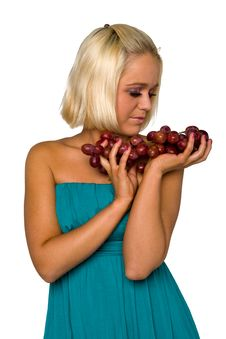 Free Blonde Girl In Blue With Grapes Stock Photos - 8481473