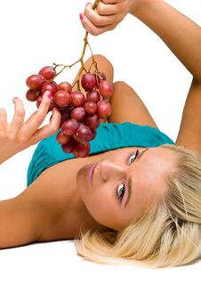 Free Blonde Girl In Blue With Grapes Royalty Free Stock Photos - 8481488