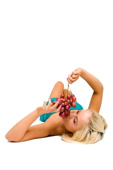 Free Blonde Girl In Blue With Grapes Stock Photography - 8481502