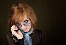 Pretty Girl With Blue Glasses Stock Images