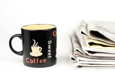 Free Coffee Cup And Stack Of Newspapers Royalty Free Stock Image - 8484396