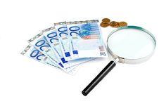 Isolated Euro Money Under The Reading Glass Kept I Royalty Free Stock Photos