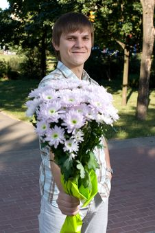 Free Boy Presenting Flowers Stock Image - 8485331