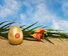 Free Easter Golden Egg And Flowers Over Blue Sky Royalty Free Stock Photos - 8485358