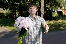 Free Boy Presenting Flowers Royalty Free Stock Photo - 8485365