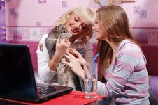 Free Two Women With Laptop And Cat Royalty Free Stock Image - 8485486