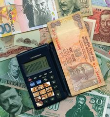 International Currencies With Calculator. Stock Photography