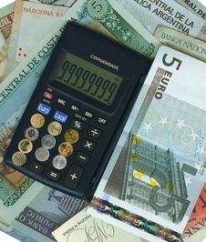 International Currencies With Calculator. Stock Photos