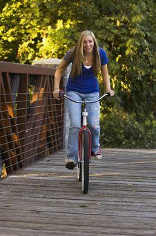 Free Female Riding A Bike Royalty Free Stock Image - 8489136