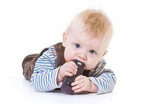 Free Little Boy Gnawing Cellular Phone Stock Photography - 8489222