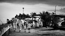 Free Family Walking Beside The Sea Royalty Free Stock Images - 84898829