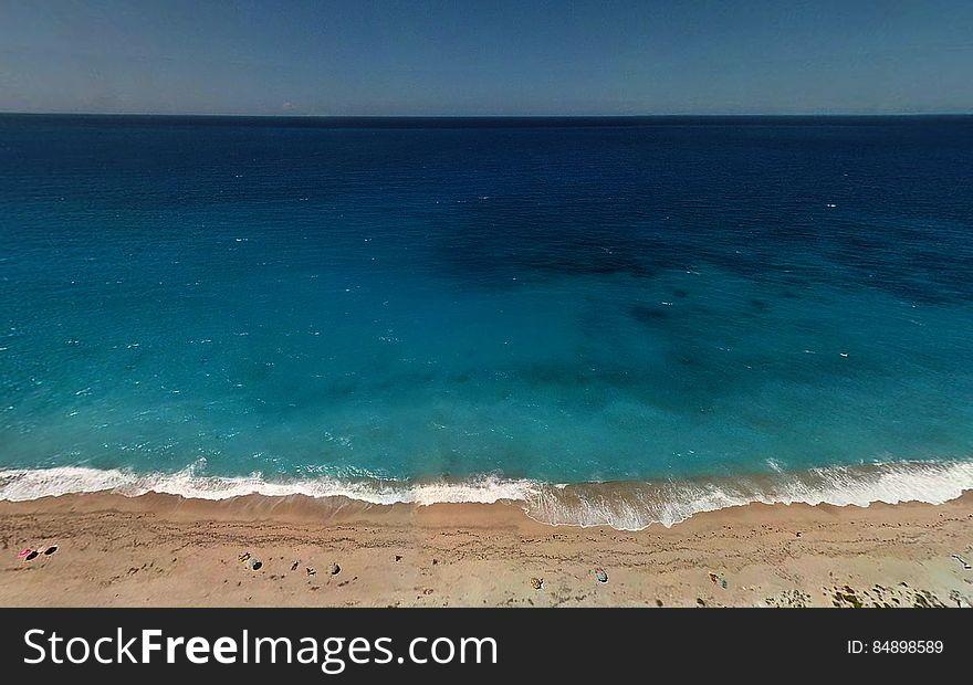 Turquoise Ocean Water by Beach