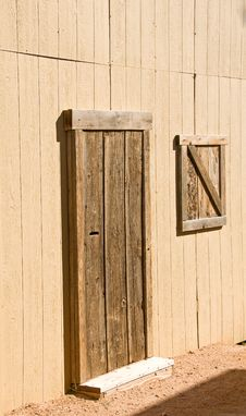 Unpainted Wooden Barn Door And Window