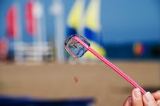 Ice Cube On Hot Beach Royalty Free Stock Images