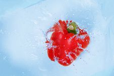 Free Pepper Falling Into Blue Water Stock Images - 8491934