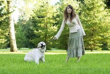 Free Girl With The Golden Retriever In The Park Royalty Free Stock Photo - 8492005