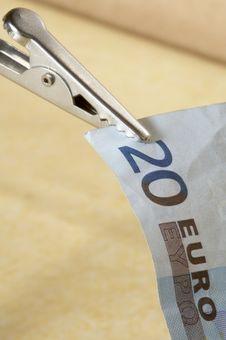 Twenty Euro Banknote With Tweezers Royalty Free Stock Photo