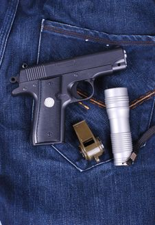 Pistol,flashlight And Whistle On Cloth Of Jean Royalty Free Stock Images