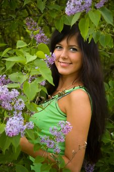 Free The  Girl And Blossoming Lilac Royalty Free Stock Images - 8495649
