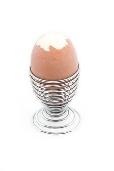An Eggcup With A Pealed Egg Stock Images