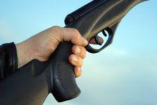 Free Man Hand Holding Gun Over Sky Stock Image - 8496471