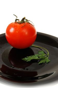 Tomato And Parsley Stock Images