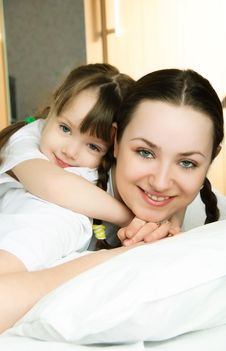 Mother And Daughter On The Bed Royalty Free Stock Photo