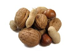 Assorted Nuts On A White Background Stock Images