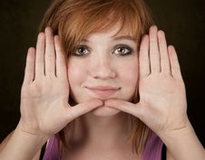 Pretty Teenager Framing Her Face Royalty Free Stock Photos