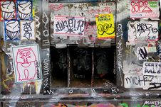 Free Sticker-and-graffiti-covered Wall With Openings Stock Photo - 84904570