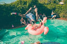 Free Time Lapse Photo Of Man In Black Tank Top Jumping On Clear Swimming Pool Royalty Free Stock Images - 84908079