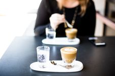 Free Selective Focus Photography Of Blended Caffeine Near Woman About To Stir Coffee Stock Image - 84908411