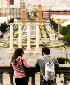 Free Man And Woman Standing Near Baluster White Looking The City Buildings Stock Image - 84909541