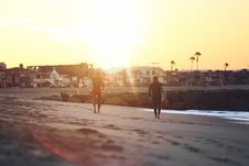 Free 2 Men Walking On Shoreline At Sunset Royalty Free Stock Photo - 84911115