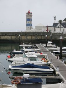 Free Lighthouse And Boats On Waterfront Royalty Free Stock Photography - 84911127