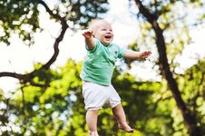 Free Young Baby Boy Jumping In Midair Stock Photography - 84913522