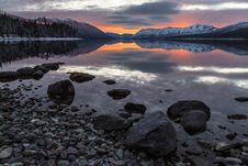 Free Cloud Reflecting On Lake At Sunset Stock Images - 84913674