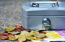 Free Coins And Bill Beside Coin Case Stock Photos - 84916363
