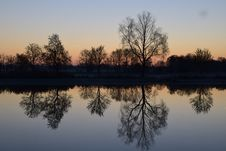Free Reflection Of Silhouette Trees In Lake Against Sky At Sunset Royalty Free Stock Images - 84917219