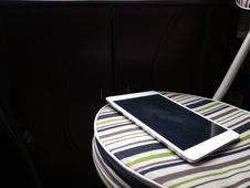 Free Apple IPad On Striped Chair Stock Photography - 84917382