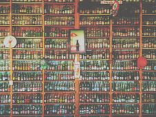 Free Collection Of Glass Soda And Beer Bottles On Shelves Royalty Free Stock Image - 84921086