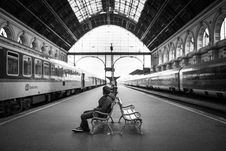 Free Man Sitting On Bench In Train Station In Grayscale Photography Royalty Free Stock Photography - 84928077
