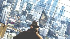Free Man Wearing Brown Coat And Brown Hat On High Rise Building At Daytime Royalty Free Stock Images - 84929659