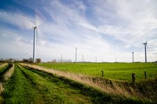 Free Wind Farm On Green Grass Pastures Royalty Free Stock Photo - 84930555