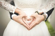Free Midsection Of Woman Making Heart Shape With Hands Royalty Free Stock Image - 84930886
