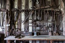 Free Black Metal Tools Hanged On A Rack Near Table Stock Photography - 84930932