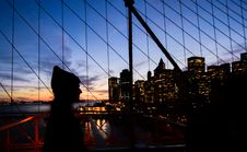 Free Person Walking On Bridge View Of Building During Night Time Stock Photography - 84930942