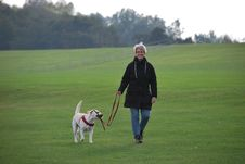 Free Woman Walking Her Dog Stock Photography - 84931482