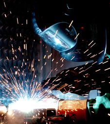Free Person In Welding Mask While Welding A Metal Bar Stock Photo - 84932870