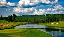 Free Golf Course With River And Clouds Stock Photos - 84933053